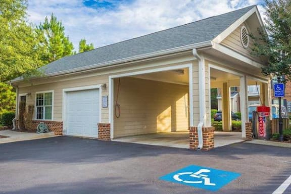 car care center with handicapped space in front