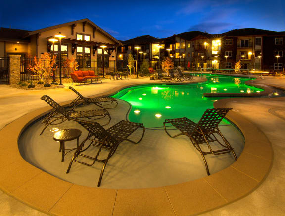 Glimmering Pool With Relaxing Chairs at The Trails at Timberline, Fort Collins, CO, 80525