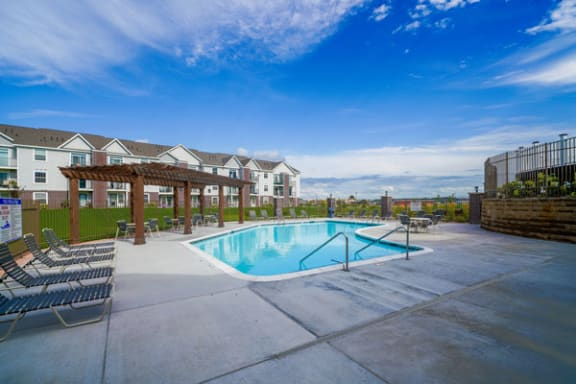 Swimming Pool with Pergola Outdoor Pool Area at Andover Pointe Apartment Homes in Nebraska