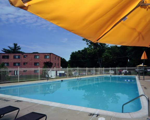 swimming pool at Overlook apartments in Hyattsville MD with close up of umbrella in top right