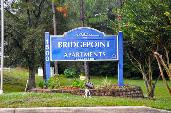 Bridgepoint Apartments monument sign surrounded by trees