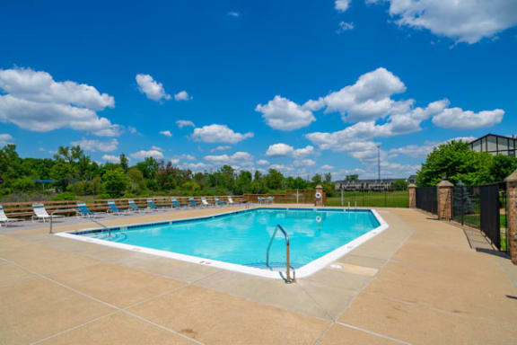 Lounge Chairs on Sundeck by Large Pool at Trappers Cove Apartments, Lansing, MI, 48910
