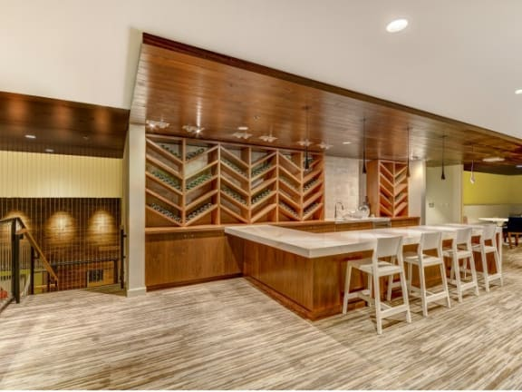 Clubroom with built-in bar at The Whittaker, Seattle, WA,98116 has Clubroom with built-in bar and wine storage