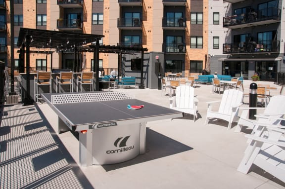 Outdoor Dining and Gaming Area at The Axis, Plymouth, MN 55441