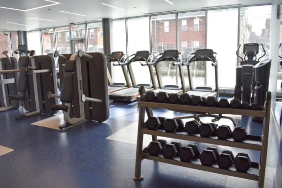 Cardio and Strength Training Equipment featuring machines and free weights at The Foundry at 41st apartments in Lawrenceville, Pittsburgh 15201