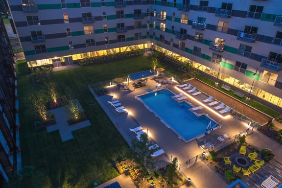 Nighttime View of Outdoor, Heated Pool at The Foundry at 41st Apartments, Lawrenceville, Pittsburgh, PA