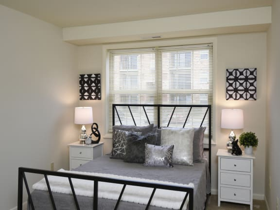 Iron Bed Frame With Comfortable Bedding at Cromwell Valley Apartments, Towson, MD