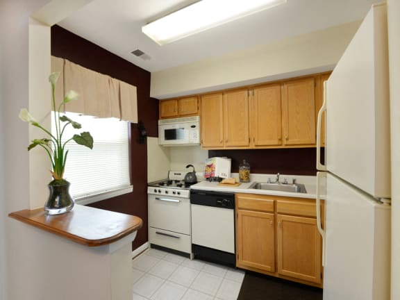 Eat in kitchen with plenty of cabinet space at McDonogh Village Apartments