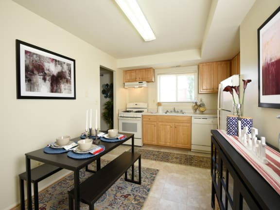 Fully equipped kitchen with dishwasher, refrigerator and stove at Arbuta Arms Apartments