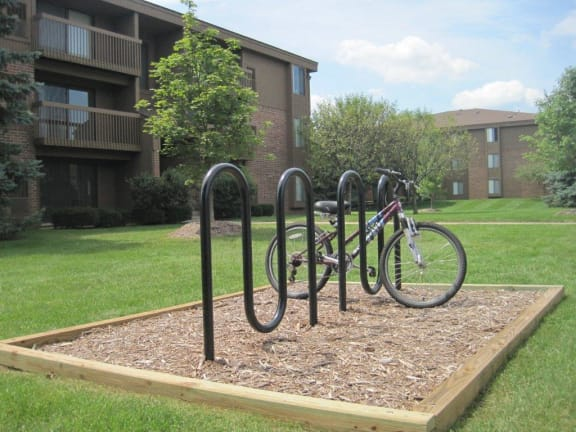 Outdoor Bike Racks and exterior building at Dover Hills Apartments in Michigan 48185