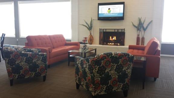 Clubhouse with couches and fireplace at Dover Hills Apartments, Kalamazoo, MI