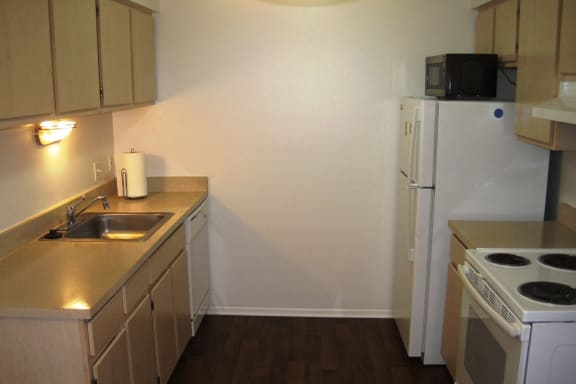 Kitchen in Short-Term Furnished Unit Available at Dover Hills Apartments in Kalamazoo, MI