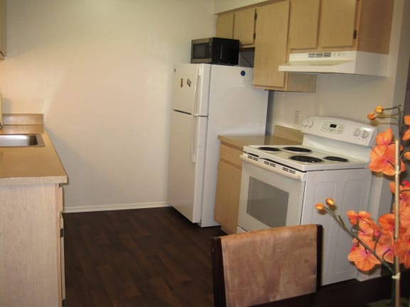 Kitchen in short-term furnished apartment available at Dover Hills Apartments in Kalamazoo, MI