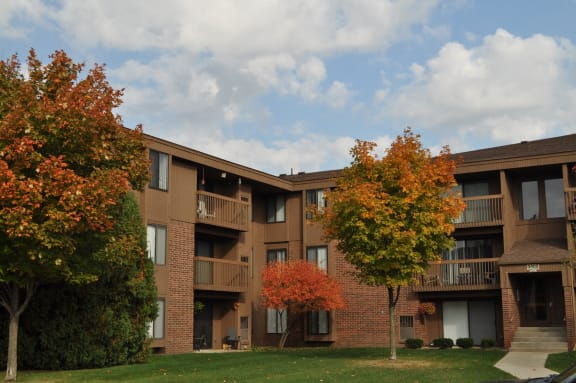 Exterior brick building with landscaped courtyard at Dover Hills Apartments in Kalamazoo, Michigan