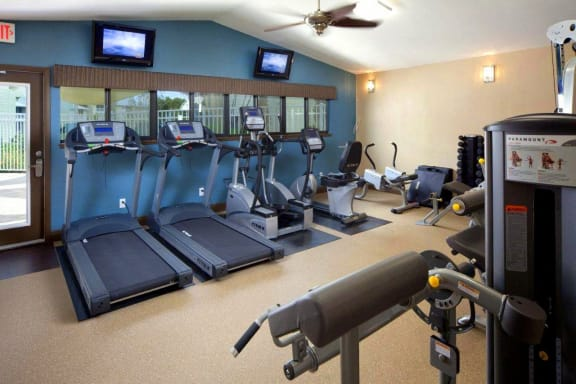 Coral Club Fitness Center with treadmills