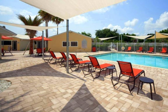 Coral Club Outdoor Pool and Sundeck with lounge chairs