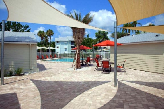 Coral Club outdoor lounge and sundeck with cabanas