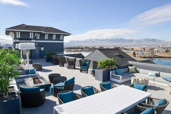Rooftop pool deck, fire pit, and gathering area with patio heaters