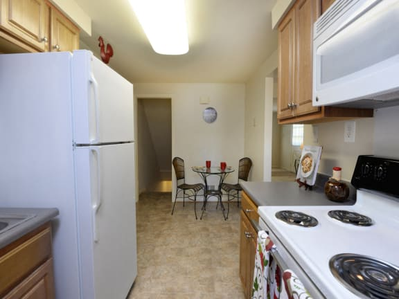 Bright, Eat-In Kitchen with Plenty of Counter Space at Walnut Grove Townhomes