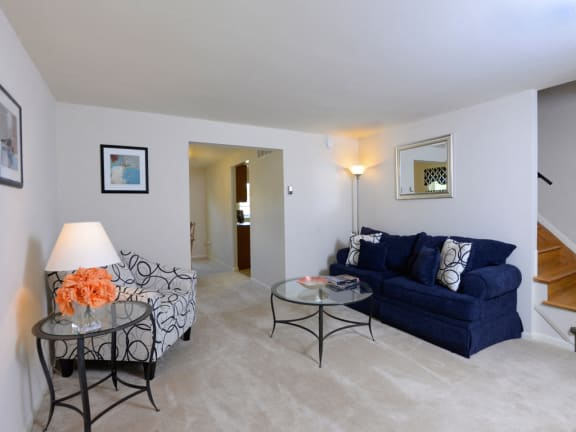 Carpeted living room with bright, natural light at Walnut Grove Townhomes