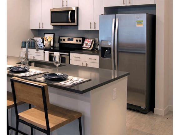 Fully Equipped Kitchen at Cycle Apartments, Colorado