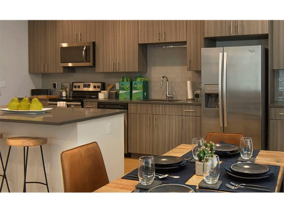 Spacious Kitchen with Pantry Cabinet at Cycle Apartments, Ft. Collins, CO, 80525