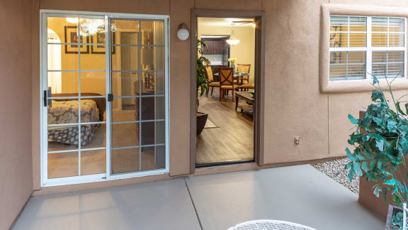 La Reserve patio with glass doors and lounge area