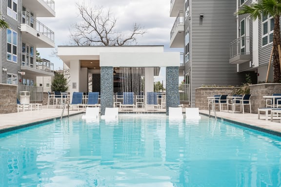 Pool And Sundeck With Social Area, Fire Pit, And Bar at Azure Houston Apartments, Texas, 77007