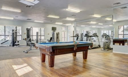 Game room with billiards tables at The Colony Apartments, 351 N Peart Rd