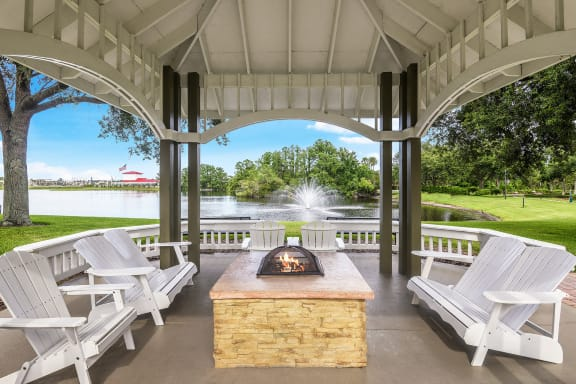 The Colony at Deerwood Apartments lakeside gazebo with fire pit and seating area