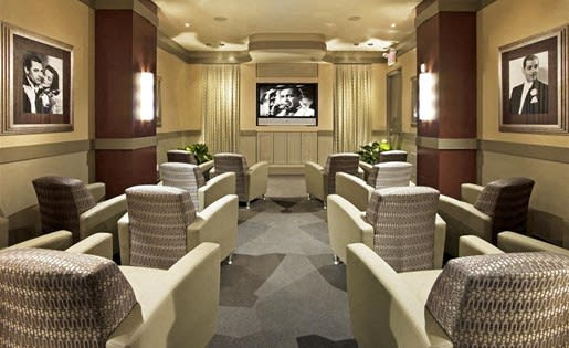 Trio Apartments includes a private movie theater for residents