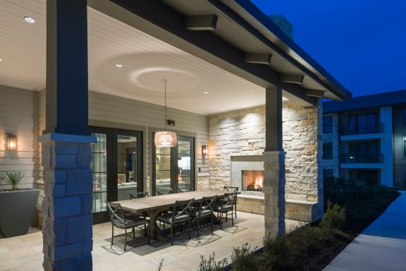Outdoor Dining Area with Fireplace at Windsor Lantana Hills, Austin, Texas