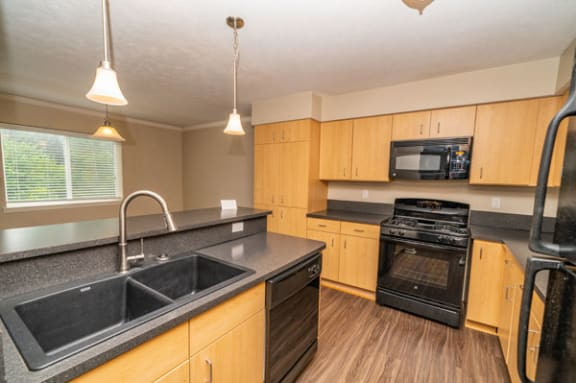 Townhome Kitchen with Island at Lynbrook Apartments and Townhomes in Elkhorn, Nebraska