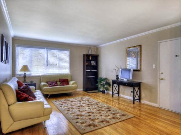 spacious living area with hardwood floors | Chase Knolls Garden Apartments Sherman Oaks CA