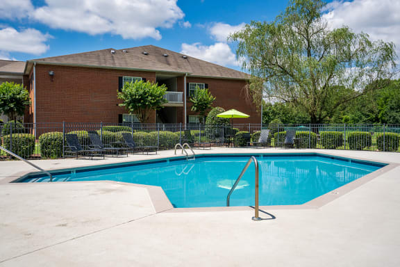 Fenced In Pool Area with Expansive Sundeck and Lounge Chairs