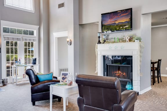 Clubhouse Lounge Area with Mounted TV and Fireplace