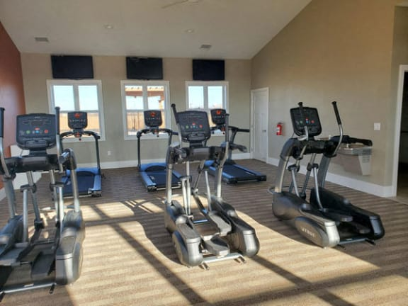 24-hour Fitness Center at Copper Creek Apartment Homes in Maize, KS