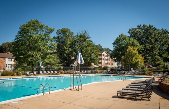 large swimming pool and sundeck at Amberleigh apartments in Fairfax VA