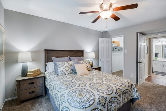 Bedroom with Walk-In Closet and Ceiling Fan