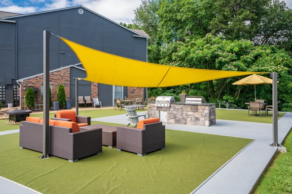 Outdoor Green Space with Grills and Lounge Furniture