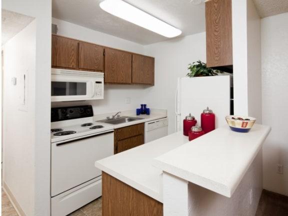 Kitchen & Breakfast Bar at Casa Bella Apartments in Tucson, AZ