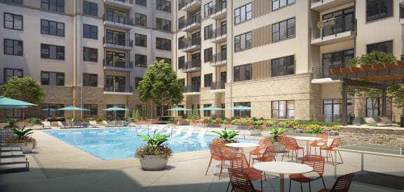 Swimming Pool with Lounge Chairs at Link Apartments Innovation Quarter, Winston-Salem, NC