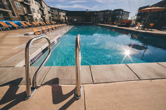 North Main at Steel Ranch Apts in Louisville CO near Cowboy Park l Pool and lounge chairs