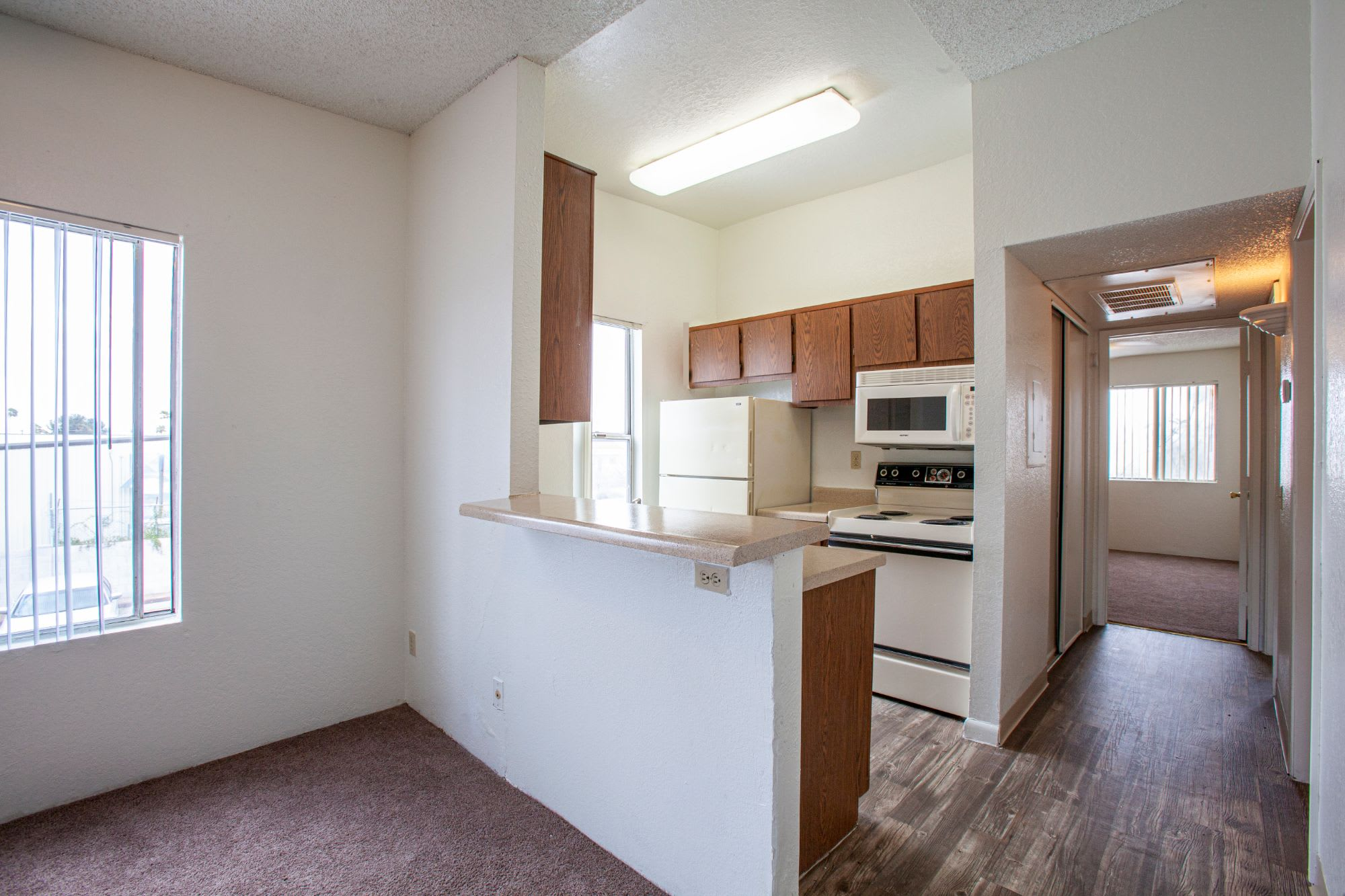 Kitchen and living room at Casa Bella Apartments in Tucson AZ 4-2020