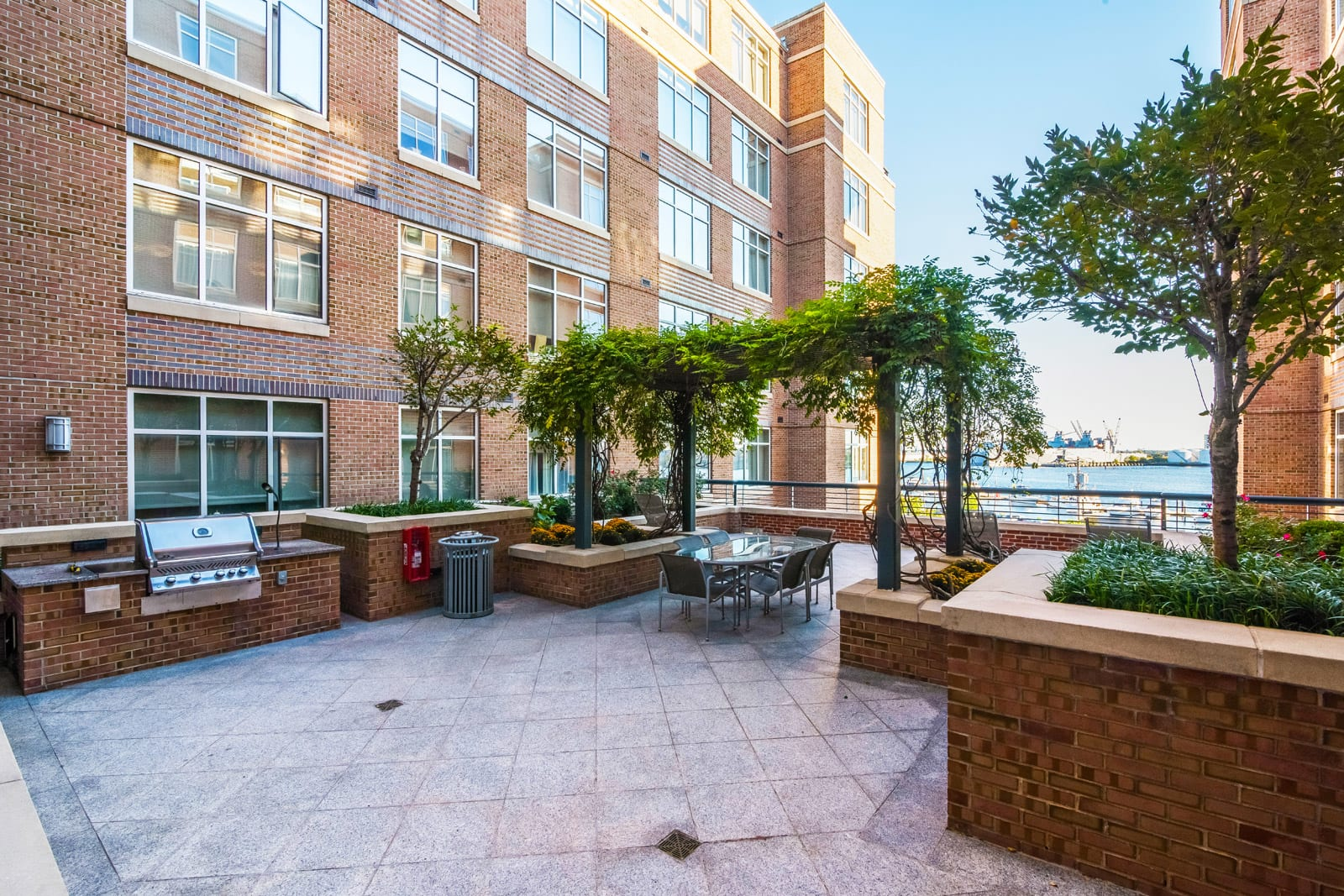Courtyard with Grill and Picnic Area at Crescent at Fells Point by Windsor, Baltimore, MD