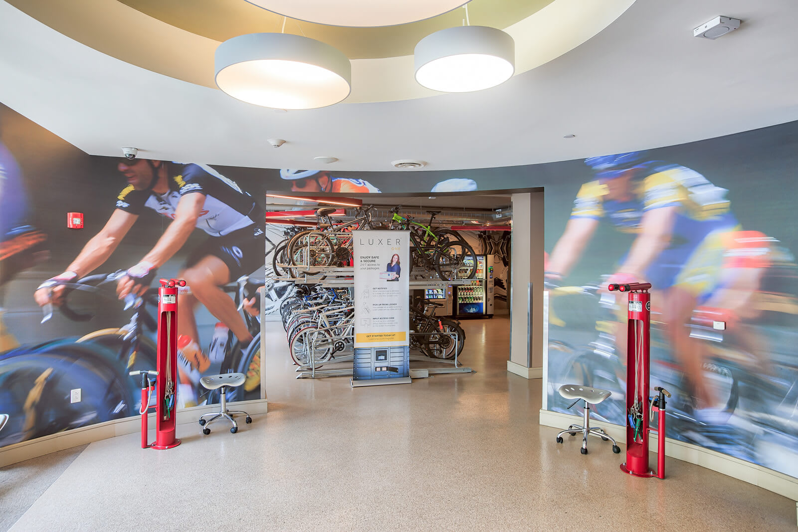 Bike Lounge Equipped with Repair stations, Seating and TVs at Windsor at Cambridge Park, Cambridge, 02140