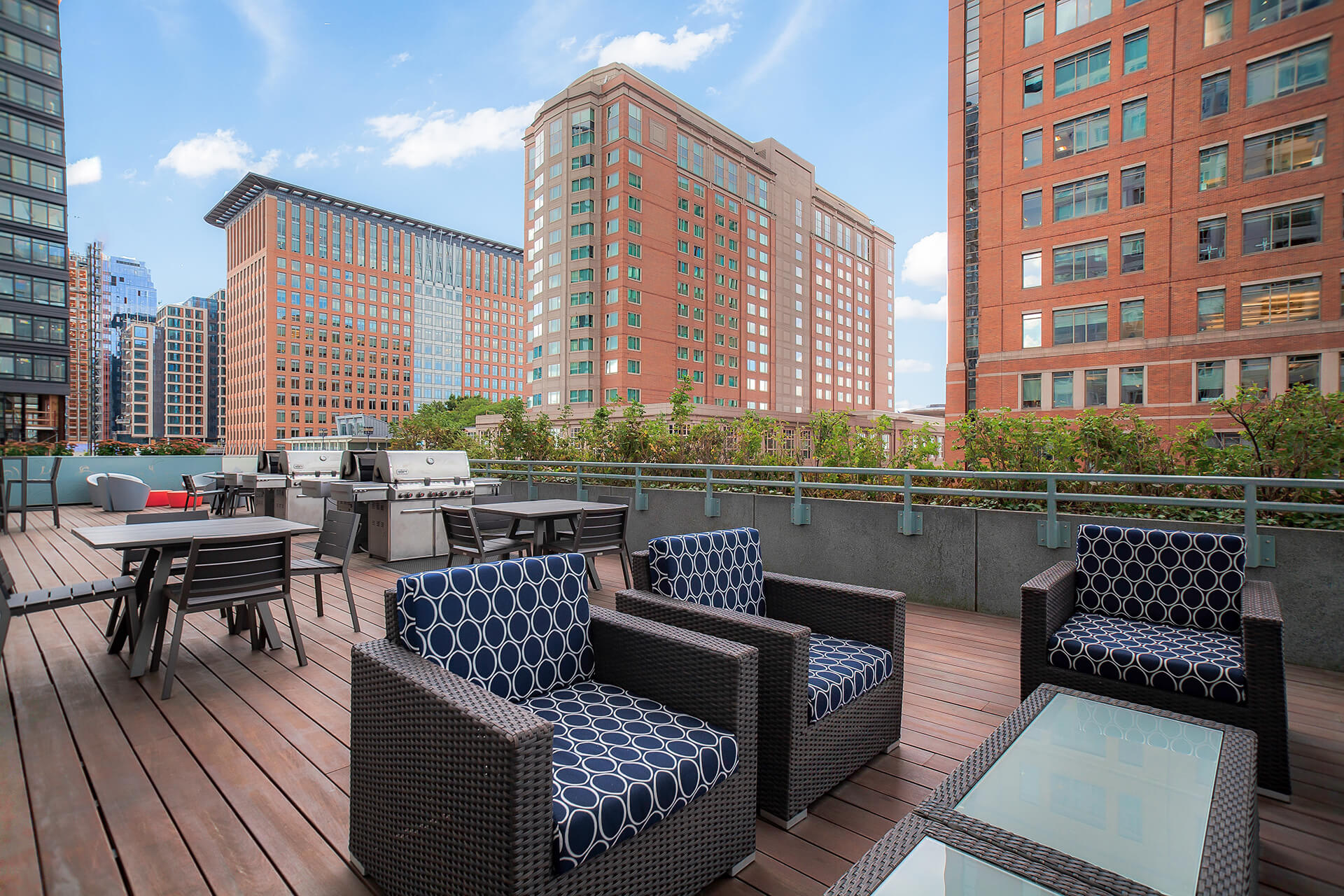 Elevated Outdoor Living Space with Multiple Grills and Dining Area at Waterside Place by Windsor, 505 Congress St, Boston