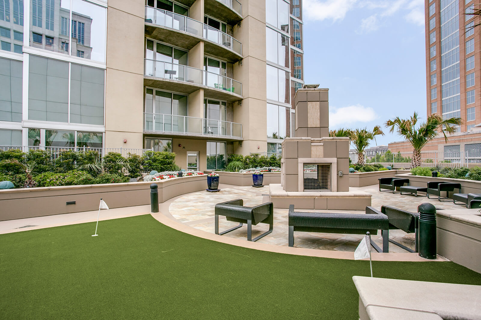 Outdoor Fireplace and Lounge Area at Glass House by Windsor, 2728 McKinnon Street, Dallas