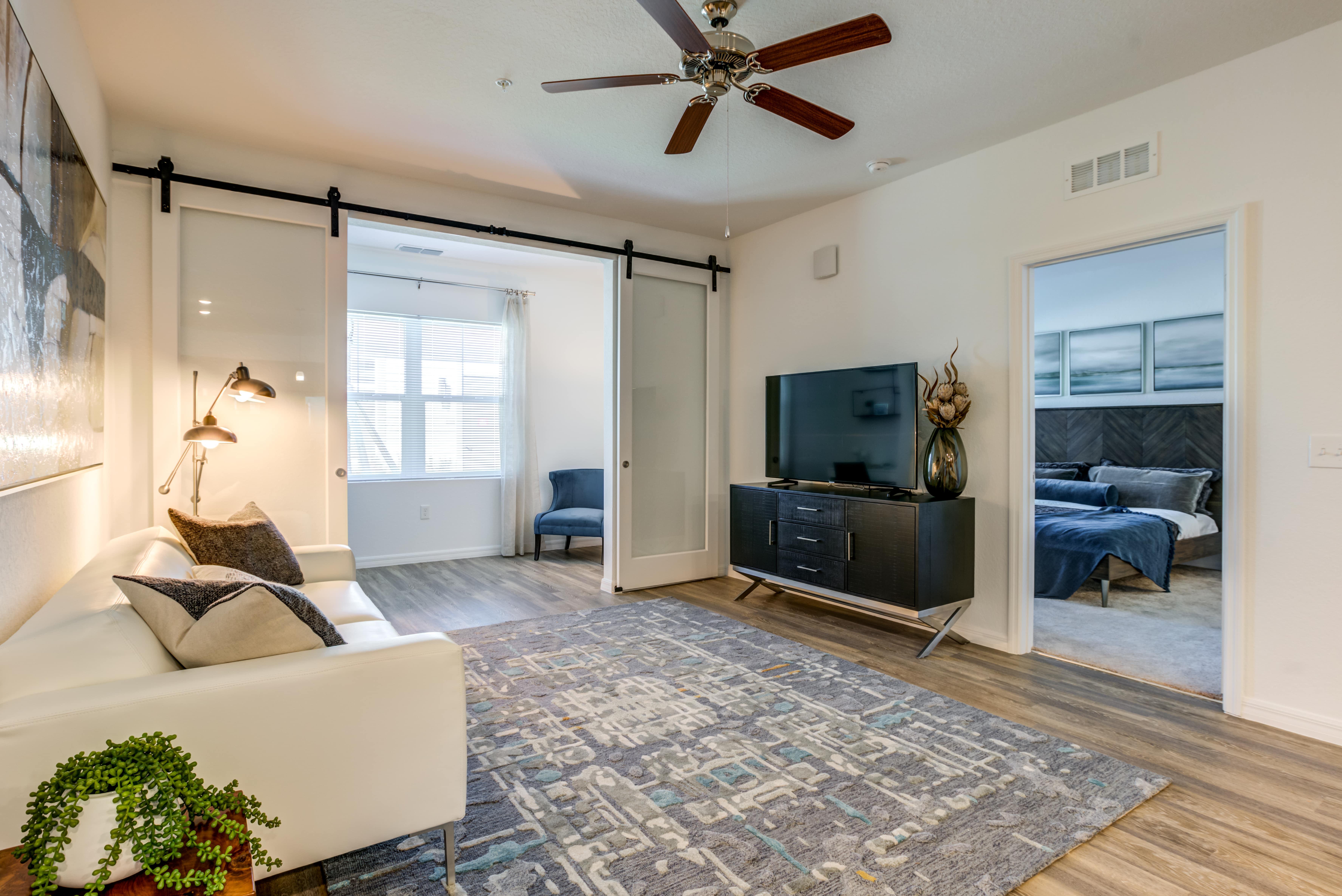 Living room with barn doors and hardwood floors