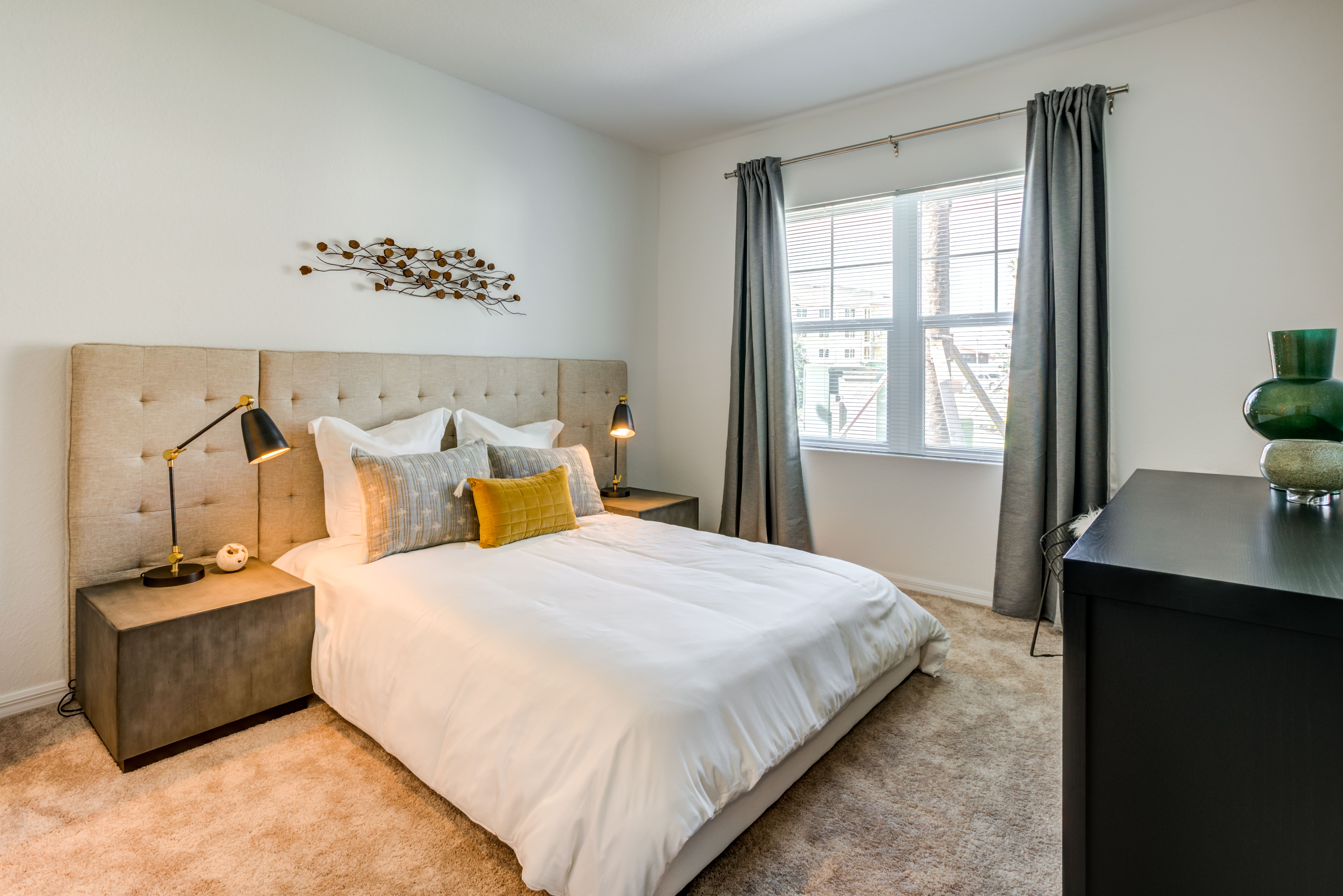 spacious, carpeted bedroom